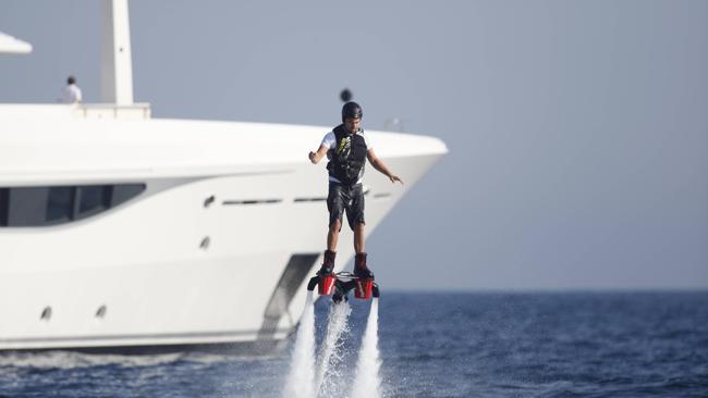 It's a bird! It's a plane! No wait, it's just DiCaprio defying gravity. Picture: Splash News
