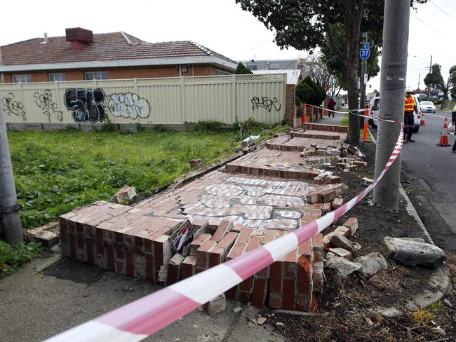 High winds have caused this wall to collapse in Williamstown Rd. Picture: Richard Serong
