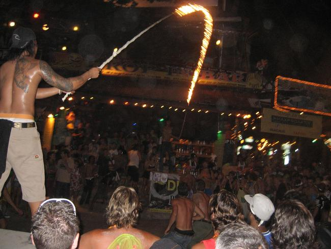 The flaming rope ... Revellers partying during a Full Moon Party in Thailand. Picture: News Corp Australia