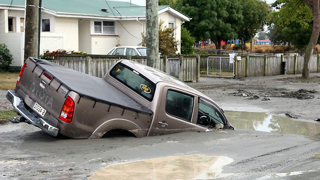 A vehicle stuck in the liquification after a magnitude 6.3 earthquake in Christchurch, New Zealand / AAP