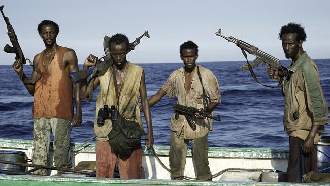 """Faysal Ahmed, Barkhad Abdi, Barkhad Abdirahman, Mahat Ali, in a scene from the film, """"Captain Phillips."""" (AP Photo/Copyright Sony — Columbia Pictures, Jasin Boland)"""