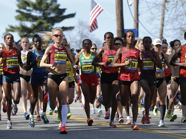 From left, Rita Jeptoo, Shalane Flanagan, Yeshi Esayias, Buzunesh Deba, Mare Dibaba, and Jemima Jelagat Sumgong run shortly after the start in the women's division of the 118th Boston Marathon Monday. Picture: Michael Dwyer
