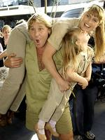 <p>Steve playfully picks up Terri and Bindi, at the Sydney premiere of his film <em>The Crocodile Hunter : Collision Course</em>. Picture: Ap</p>