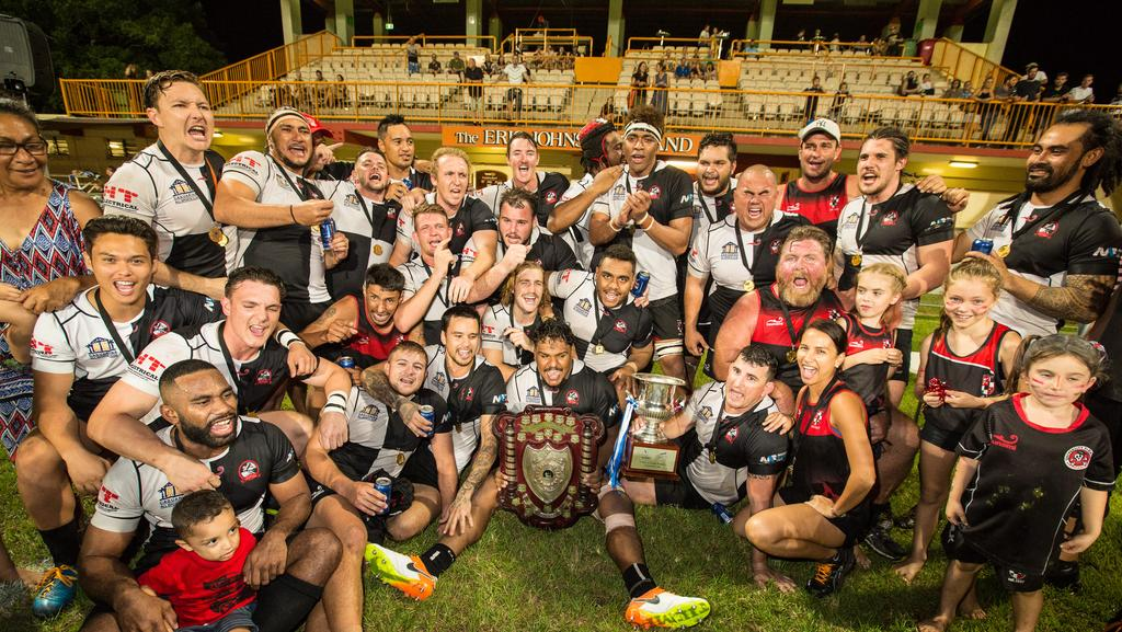 <s1>  Uni Pirates celebrate their victory over the Casuarina Cougars in the NTRU decider on Saturday night </s1>. Picture: Glenn Campbell