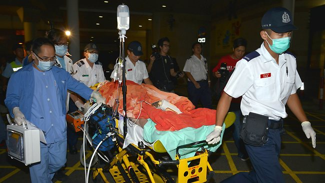 Medical personnel transfer a victim from an ambulance at a hospital after at least 30 people were injured in a collision between a ferry and another commercial vessel off Hong Kong on October 1, 2012. More than 30 people were injured in a collision between a ferry and a tug boat which threw scores of people into the sea off Hong Kong, police said. The government said around 120 people were on board the vessels, of whom 101 had been rescued. AFP PHOTO / Antony DICKSON