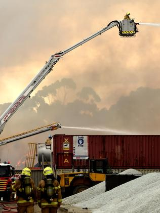Smoke fills the air as crews work to extinguish the blaze. Picture: Nicole Garmston