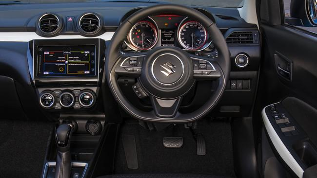 The Suzuki is the only car here with Apple Car Play — and the only one without a volume dial. Touchscreens and steering wheel audio controls are not ideal on bumpy roads. Photo: Supplied.