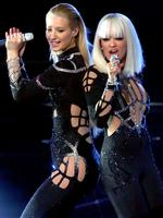Rapper Iggy Azalea (L) and singer Rita Ora perform onstage during the 2014 MTV Video Music Awards at The Forum on August 24, 2014 in Inglewood, California. Picture: Getty