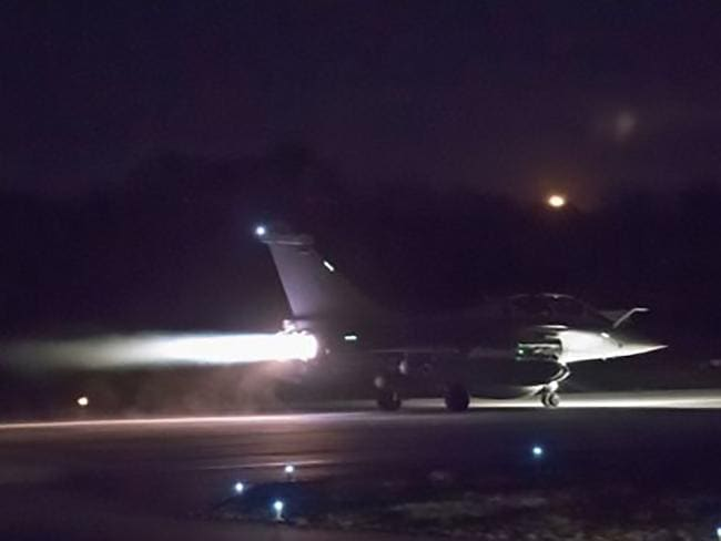 French military aircraft launching early, as western strikes hit Syrian military bases and research centres in and around the capital and the country's centre. Picture: AFP