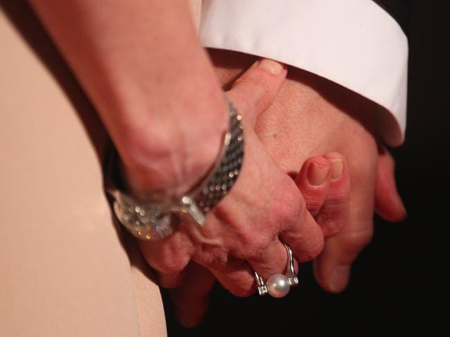 In love ... Nicole Kidman and Keith Urban hold hands.