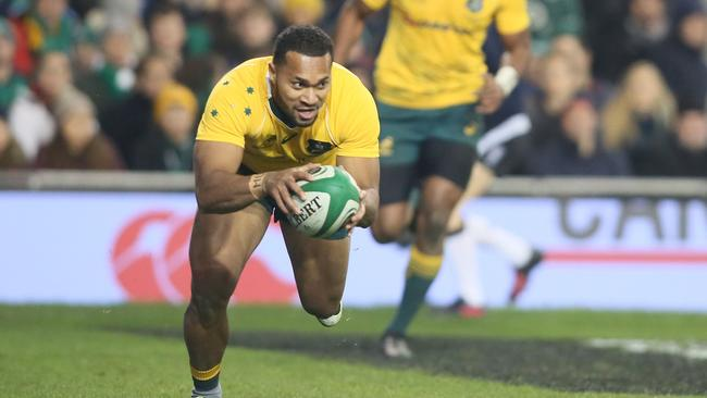 Australia's Sefanaia Naivalu scores a try during the rugby union test match between Ireland and Australia.