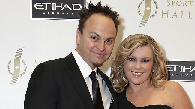 Steven Bradbury (pictured with wife Amanda) put his foot squarely in it at West Coast's season launch Picture: Julie Kiriacoudis