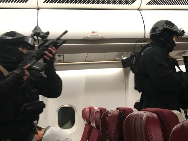 Armed police board the Malaysia Airlines flight. Picture: Andrew Leoncelli