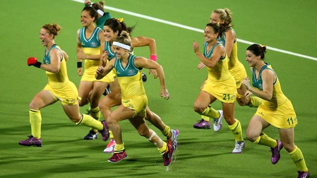 Australia players celebrate winning the gold medal.
