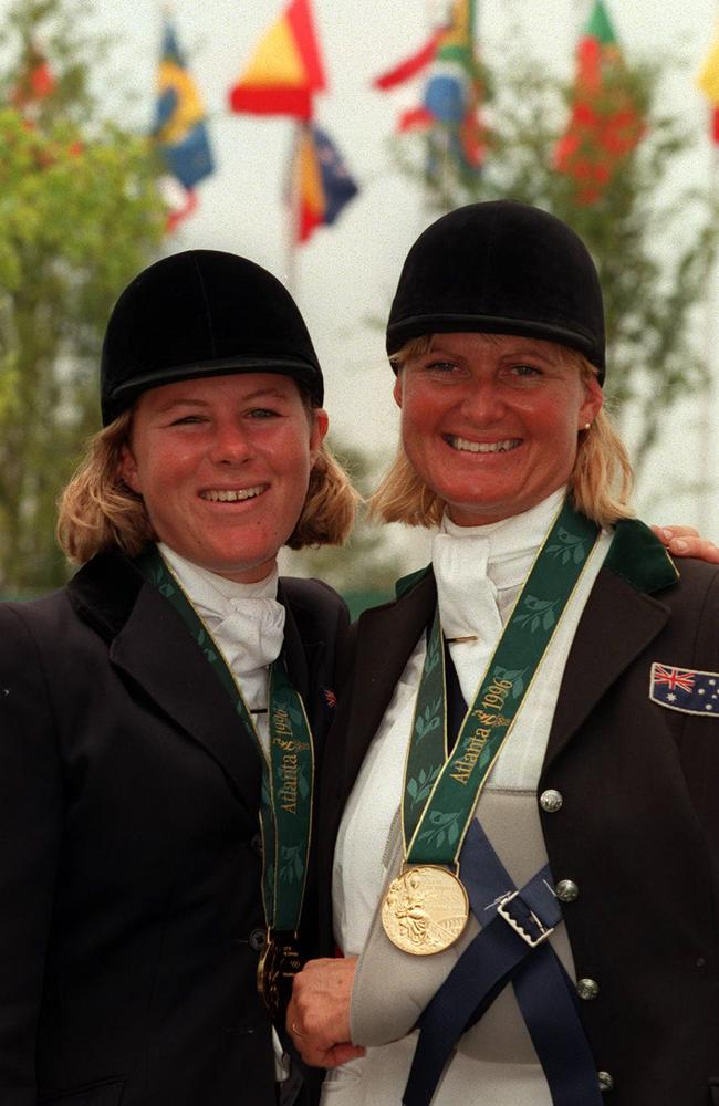 Injured Gillian Rolton, right, with Wendy Schaeffer wearing gold medals at the Atlanta Olympic Games.