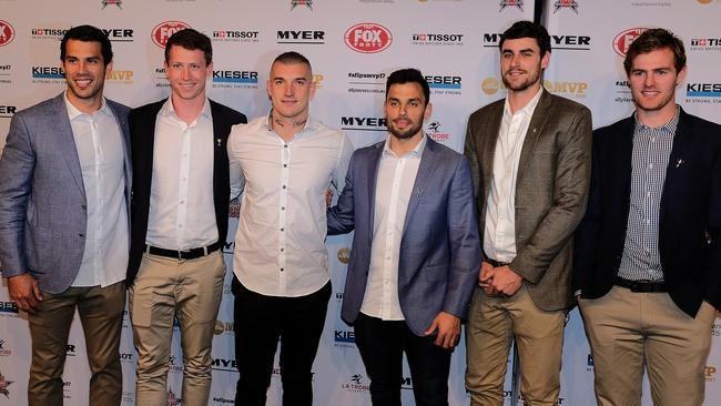Dustin Martin (third from the left) arrives with Tiger teammates. Picture: AAP