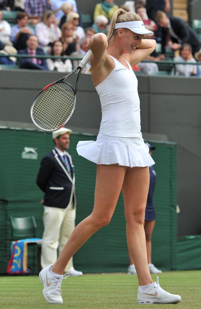 Britain's Naomi Broady reacts after missing a shot against Denmark's Caroline Wozniacki at Wimbledon.