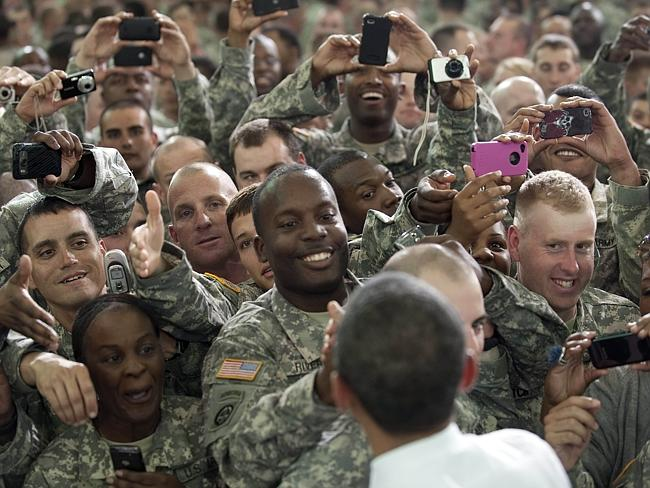 Troops at Fort Campbell take pics of President Obama.