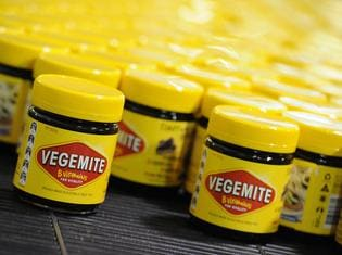 **FILE** An Oct. 24, 2013 file photo of Vegemite rolling along the production line at the Vegemite factory in Melbourne, Thursday, Oct. 24, 2013. Bega Cheese has agreed to buy brands including Australian icon Vegemite in a deal worth $460 million, Thursday, Jan. 19, 2017. (AAP Image/Julian Smith) NO ARCHIVING