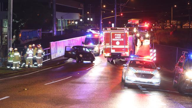 A woman has been thrown onto the train tracks at Taringa in a car-pedestrian accident. Picture: Marc Robertson