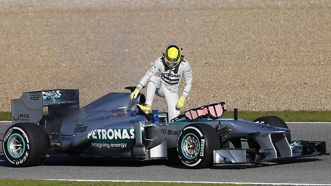 Nico Rosberg gets out of his Mercedes GP after he was forced to stop by flames and smoke rising from the rear of the car during Formula One testing at Circuito de Jerez in Spain. Picture: Miguel Angel Morenatti