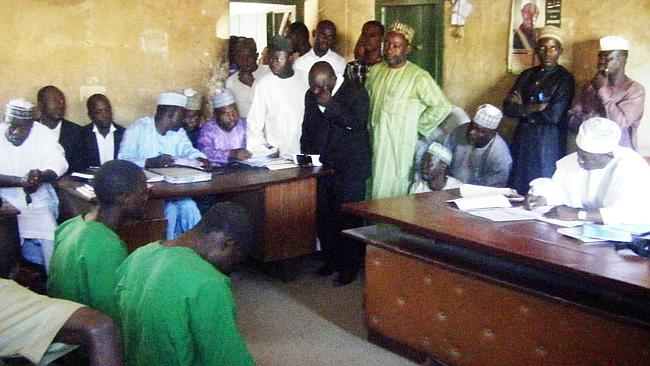 Homosexuality banned ... two men accused of being homosexual sit before Judge El-Yakubu Aliyu during court proceedings at Unguwar Jaki Upper Sharia Court in the northern Nigerian city of Bauchi last month.