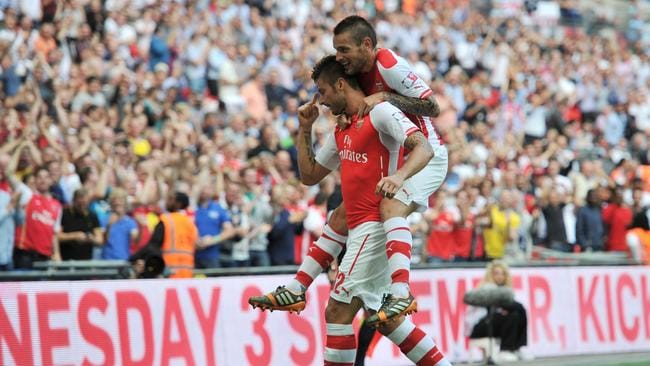 Arsenal's French striker Olivier Giroud (L) celebrates with Arsenal's French defender Mathieu Debuchy.