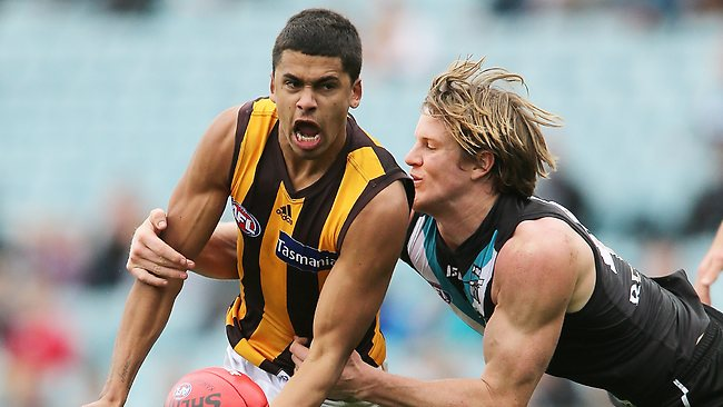 ADELAIDE, AUSTRALIA - JULY 13: Bradley Hill of the Hawks passes the ball while under pressure during the round 16 AFL match between Port Adelaide Power and the Hawthorn Hawks at AAMI Stadium on July 13, 2013 in Adelaide, Australia. (Photo by Morne de Klerk/Getty Images)