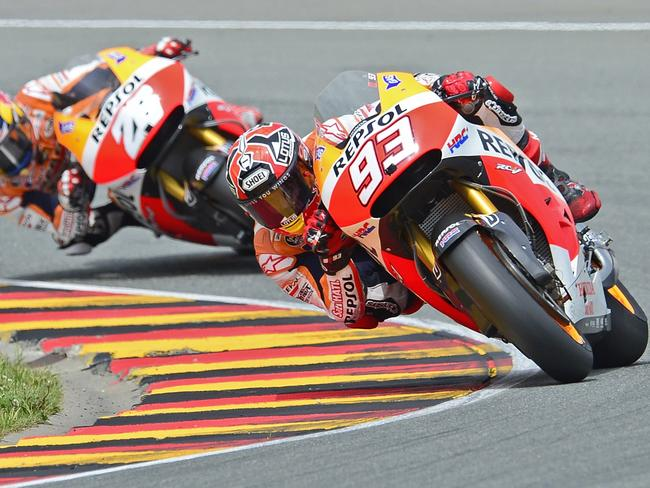 Marc Marquez leads Honda teammate Dani Pedrosa at the Sachsenring Circuit.