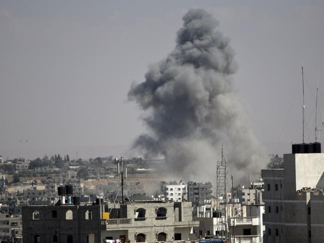 Violence ... Smoke rises following an Israeli strike in Rafah, in the southern Gaza Strip. At least 10 people were killed in a fresh strike on a UN school in southern Gaza which was sheltering Palestinians. Picture: AFP