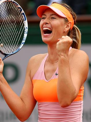 Maria Sharapova celebrates victory over Garbine Muguruza at the French Open.