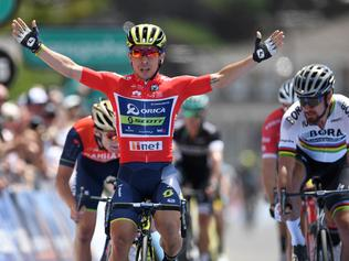 Australian rider Caleb Ewan of team Orica-Scott celebrates winning stage three of the Tour Down Under ahead of world champion Peter Sagan of team Bora-Hansgrohe (right) in Victor Harbor, near Adelaide, Thursday, Jan. 19, 2017. (AAP Image/Dan Peled) NO ARCHIVING, EDITORIAL USE ONLY