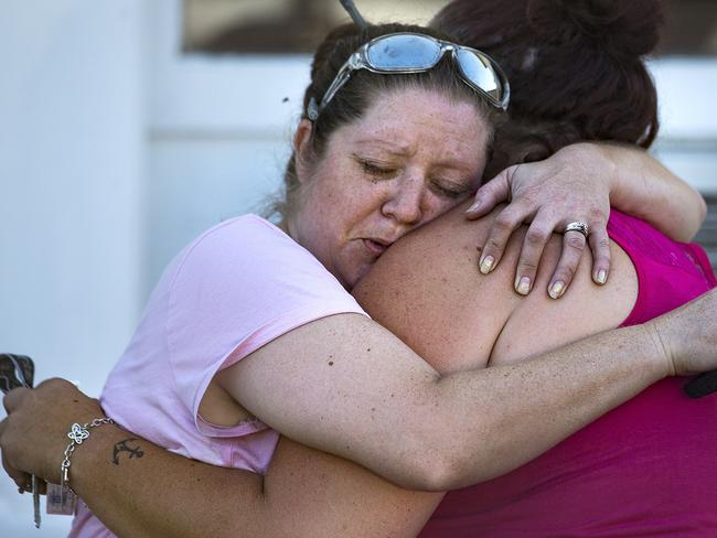 Carrie Matula embraces a woman after a fatal shooting at the First Baptist Church in Sutherland Springs, Texas. Picture: AP.