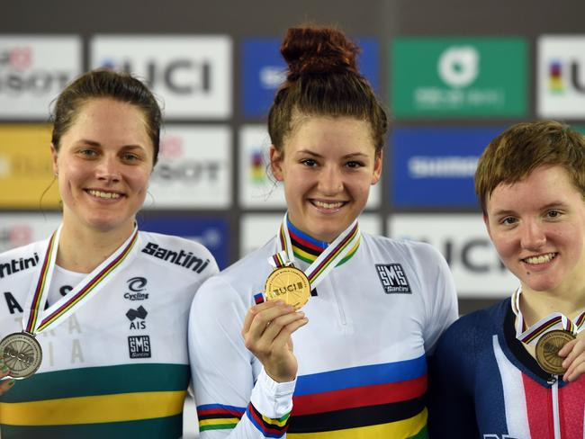 American gold medallist Chloe Dygert (C) celebrates with Aussie silver medallist Ashlee Ankudinoff (L) and bronze medallist Kelly Caitlin after the individual pursuit at the track cycling world titles.
