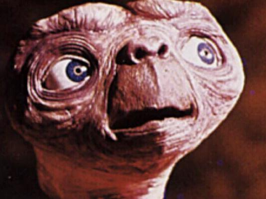 1982. ET character and child actor Henry Thomas in a scene from the film E.T. the Extra-Terrestrial.
