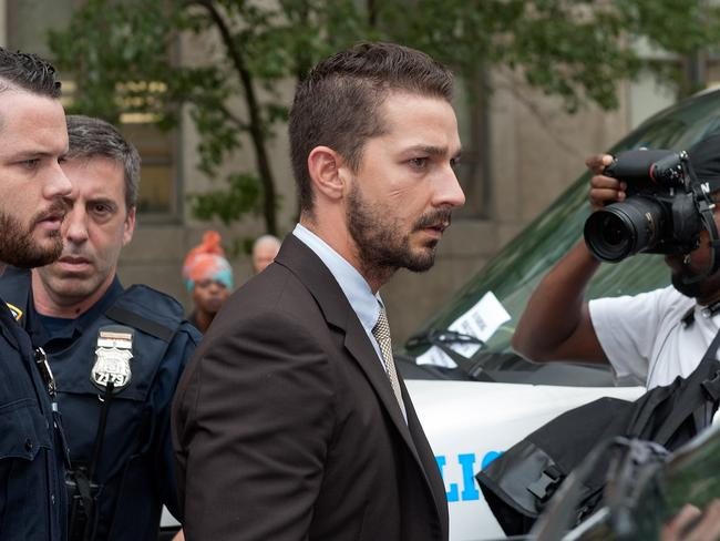 "Public meltdown ... LaBeouf leaves Manhattan Criminal Court after being charged with criminal trespass, disorderly conduct, and harassment after disturbing a performance of ""Cabaret"" last month. Picture: Getty"