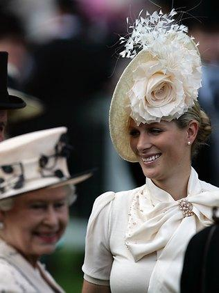 Zara Phillips, Princess Anne's daughter and Wills' cousin, shows off an incredible feathered, floral hat at Ascot. Her grandmother the Queen, in the foreground, seems to have stuck a much simpler look. Picture: AAP