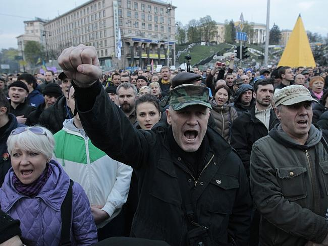 Resisting Russia ... people shout slogans during a rally in Independence Square in Kiev. Picture: Sergei Chuzavkov