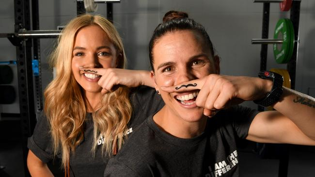 Adelaide Crows co-captain Chelsea Randall and current Miss World Australia Olivia Rogers for Movember