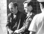 <p>Prison ... police escort Knight back to jail after an appearance in court / Supplied</p>