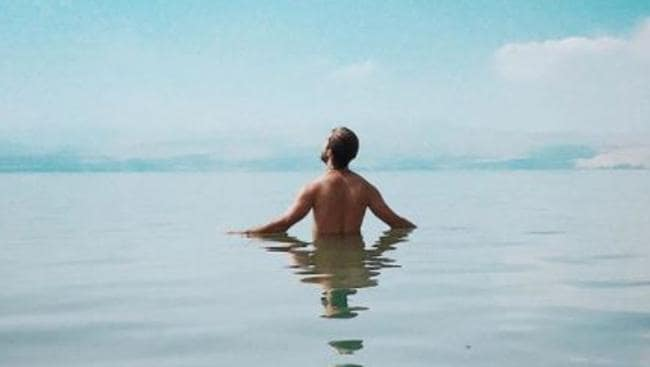Luis stopped being 'in a hurry' and took a year out to soak up experiences like this, in the Sea of Galilee: Picture: Instagram/Luis D Ortiz
