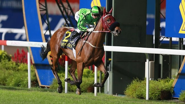Easy does it: Zac Purton rides Military Attack to victory in the Group 1 Singapore International Cup.