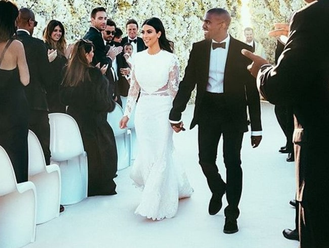 "Happy ... Kim previously shared this pic on Instagram, captioning it ""Mr & Mrs West""."