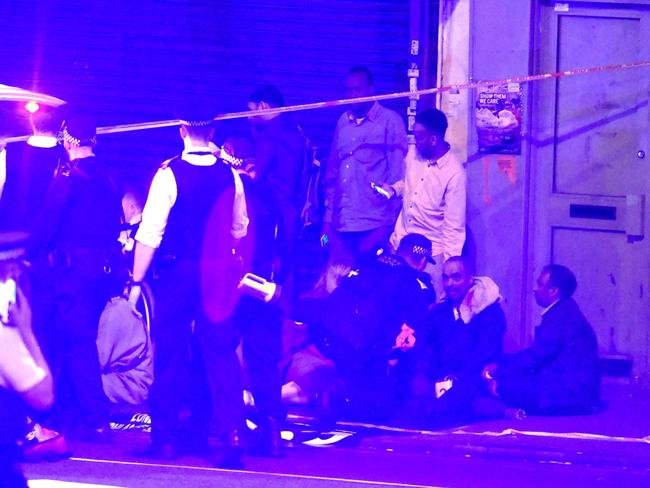 Police and ambulance crews on the scene in Finsbury Park, London, UK. Picture: REX/Shutterstock