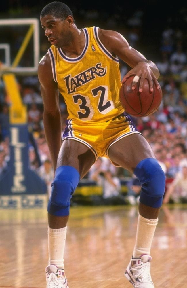 Guard Earvin (Magic) Johnson of the Los Angeles Lakers moves the ball during a game.