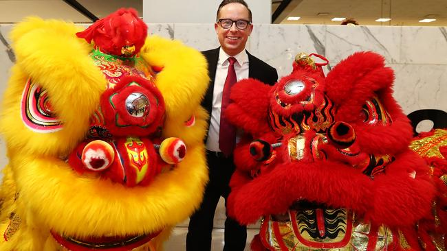 Qantas Group CEO, Alan Joyce poses with Chinese Lion dancers in Sydney Airport last year to announce the airline will commence flying direct to Beijing. Picture: John Feder.