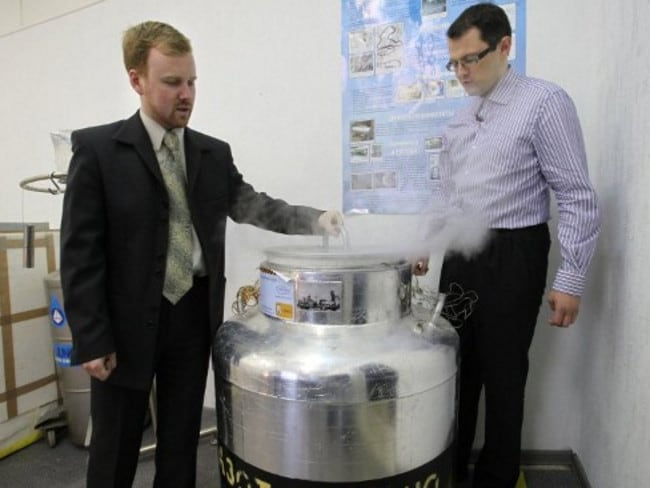 Medvedev, left, shows customer Innokenty Osadchy an ultra low-temperature human brain storage vat.