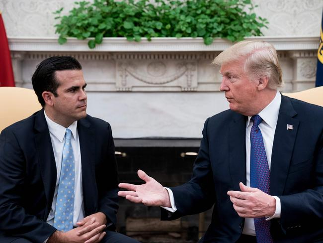 Governor of Puerto Rico Ricardo Rossello listens while US President Donald Trump makes a statement. Picture: AFP