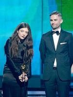 Lorde and songwriter Joel Little accept the Song of the Year award for 'Royals' onstage during the 56th GRAMMY Awards. Picture: Getty