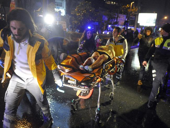 Medics carry a wounded person at the scene after the attack. Picture: IHA via AP